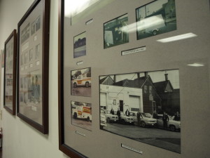 A photograph of a wall of pictures chronicalling the history of Central Exterminating Company.